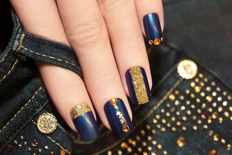 Nail polish,Manicure,Nail,Nail care,Finger,Blue,Cosmetics,Glitter,Hand,Service