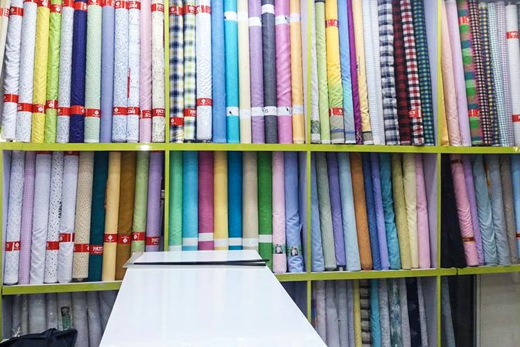 Shelf,Book,Shelving,Bookcase,Publication,Furniture,Library,Textile,Bookselling,Collection