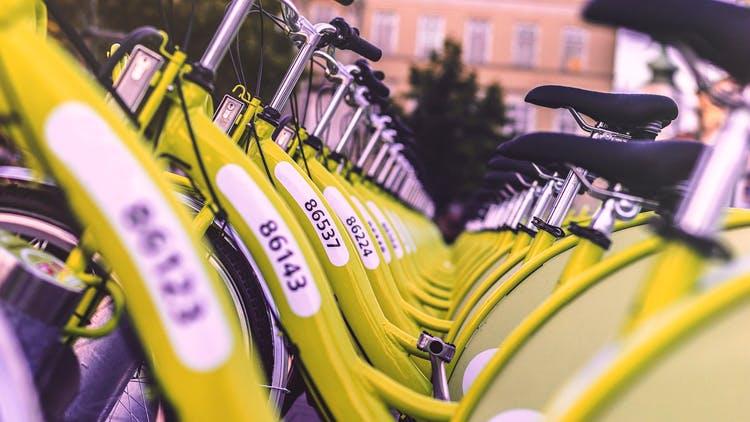 Bicycle,Green,Bicycle part,Bicycle handlebar,Hybrid bicycle,Bicycle saddle,Vehicle,Yellow,Bicycle wheel,Bicycle tire