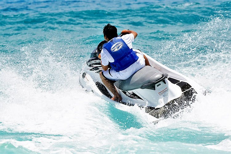 Jet ski,Personal water craft,Boating,Outdoor recreation,Recreation,Water sport,Vehicle,Sports,Wind wave,Wave