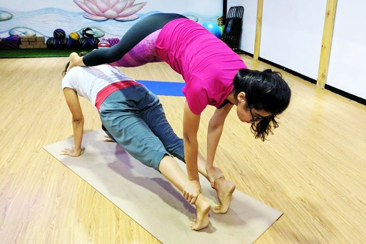Physical fitness,Yoga,Arm,Pilates,Stretching,Leg,Balance,Joint,Floor,Exercise