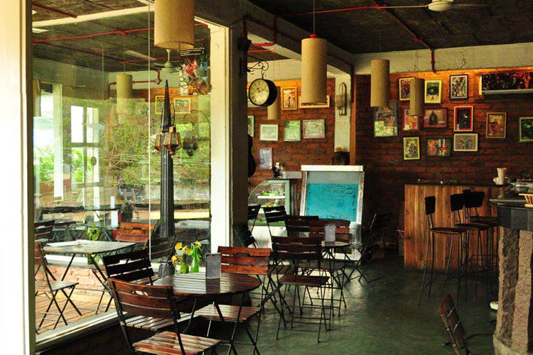 Building,Room,Interior design,House,Furniture,Table,Architecture,Home,Coffeehouse,Restaurant