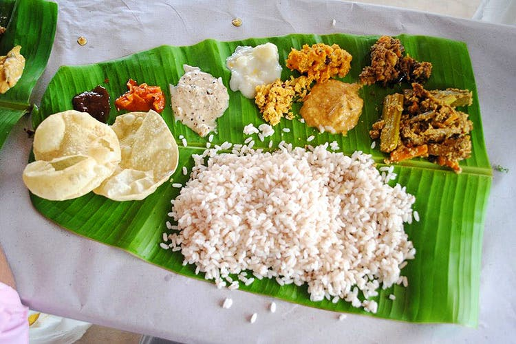 Dish,Food,Cuisine,Sadya,Banana leaf rice,Ingredient,Rice,Andhra food,Banana leaf,Leaf
