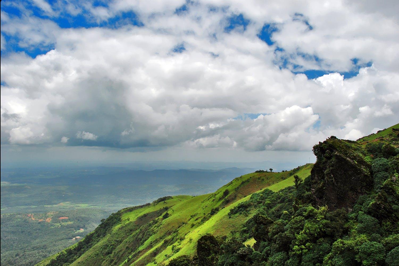 Sky,Nature,Highland,Cloud,Mountainous landforms,Green,Natural landscape,Hill,Mountain,Hill station