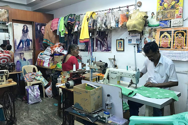 Sewing machine,Tailor,Selling,Dressmaker,Art,Textile,Shopkeeper,Building,Home appliance