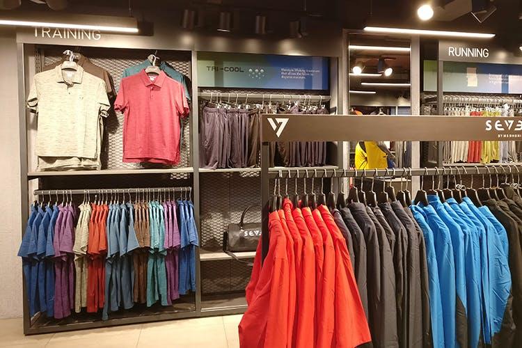 Boutique,Outlet store,Clothing,Clothes hanger,Room,Fashion,Retail,Closet,Shelf,Outerwear