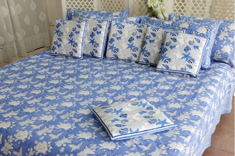 Furniture,Blue,Bedding,Bed sheet,Bed,Couch,Textile,studio couch,Room,Duvet cover