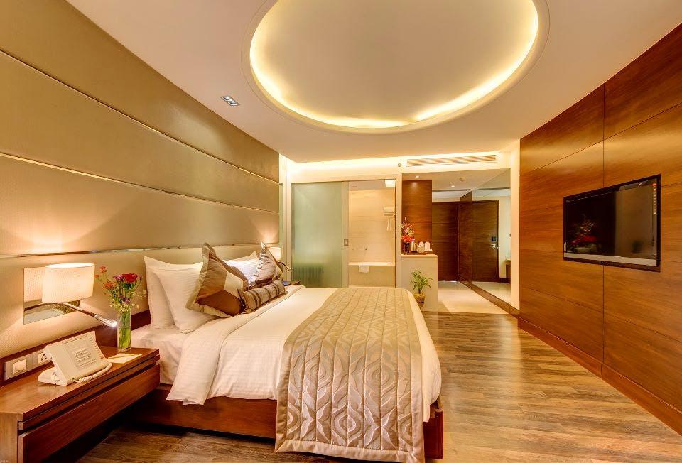 Bedroom,Room,Furniture,Interior design,Property,Ceiling,Bed,Building,Floor,Bed frame