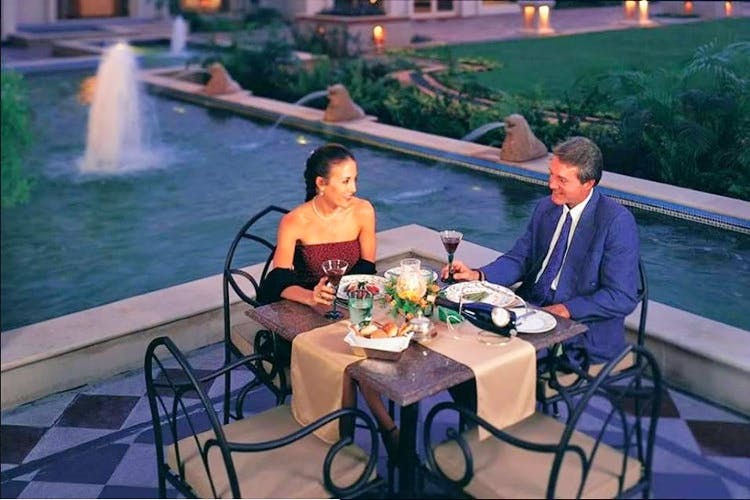 Leisure,Restaurant,Fun,Table,Backyard,Event,Furniture,Vacation,Sitting,Outdoor table