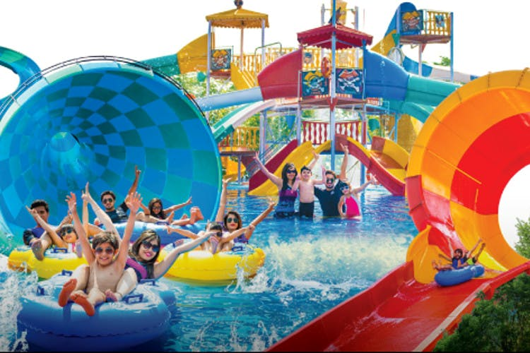 Amusement park,Water park,Fun,Leisure,Recreation,Inflatable,Park,Outdoor play equipment,Nonbuilding structure,Chute