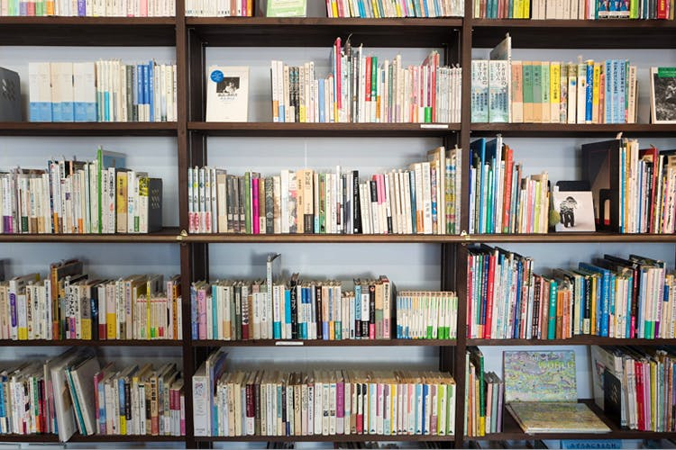 Bookcase,Shelving,Shelf,Book,Library,Publication,Furniture,Bookselling,Public library,Building