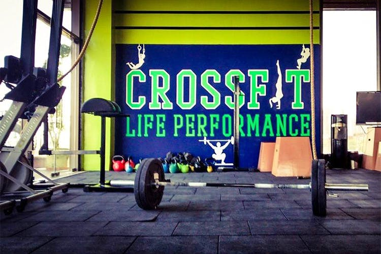 Physical fitness,Crossfit,Gym,Room,Tire,Weightlifting,Font,Banner,Advertising,Graphics