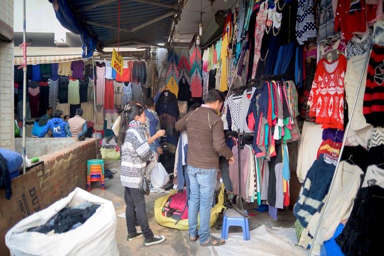 Selling,Market,Public space,Bazaar,Marketplace,Human settlement,Shopping,Flea market,City,Textile