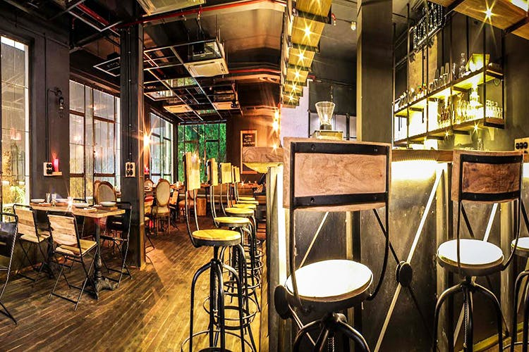 Furniture,Building,Interior design,Room,Table,Restaurant,Bar stool,Coffeehouse,Architecture,Bar