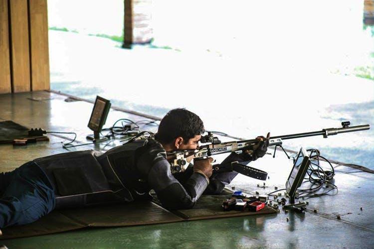 Shooting sport,Shooting,Gun,Rifle,Sniper rifle,Recreation,Soldier,Firearm,Shooting range