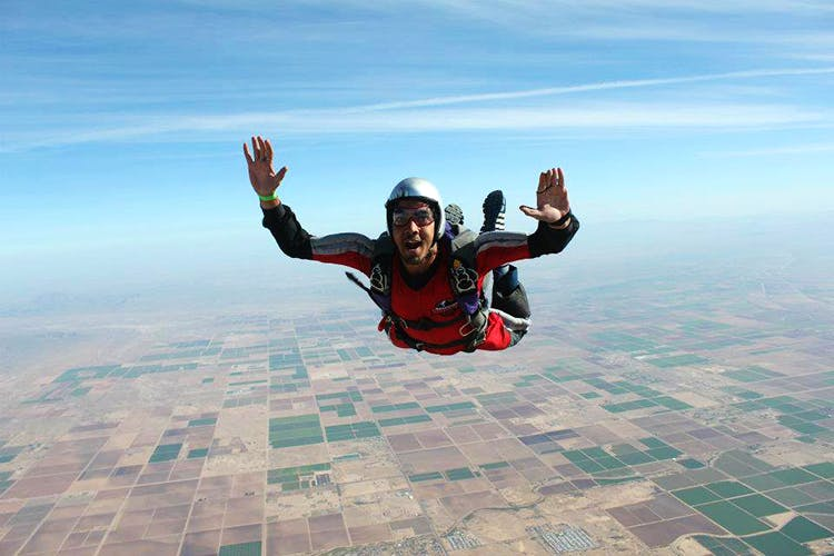 Parachuting,Air sports,Sky,Fun,Leisure,Tandem skydiving,Happy,Extreme sport,Parachute,Jumping