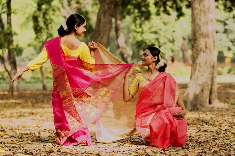 People in nature,Pink,Sari,Yellow,Tree,Tradition,Photography,Abdomen,Plant,Magenta
