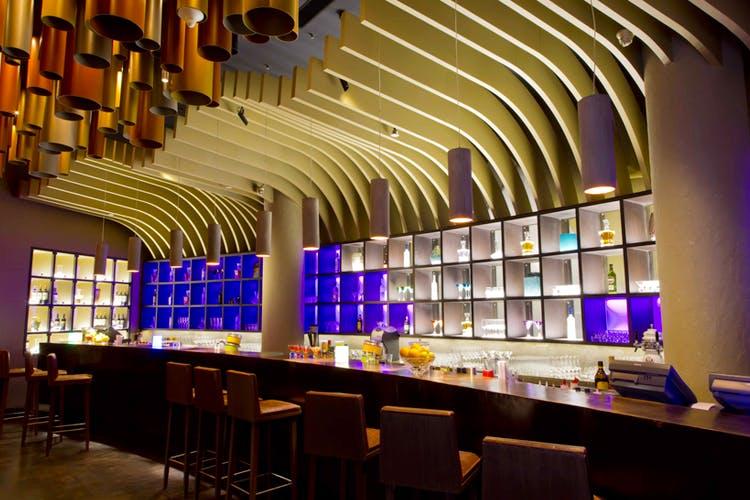 Building,Lighting,Architecture,Interior design,Ceiling,Bar,Room,Restaurant,Function hall,Glass