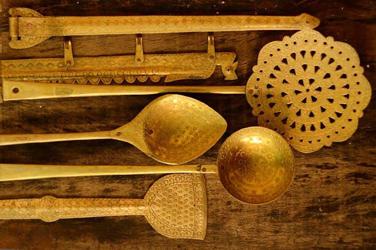 Spoon,Kitchen utensil,Cutlery,Tableware,Antique,Wood,Ladle,Brass,Still life,Metal