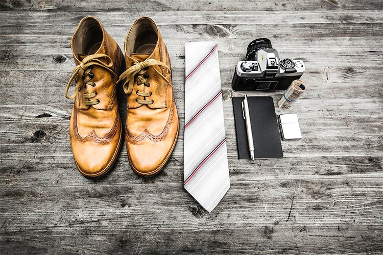 Footwear,Shoe,Brown,Fashion,Still life photography,Font,Plimsoll shoe,Photography,Oxford shoe,Reflection