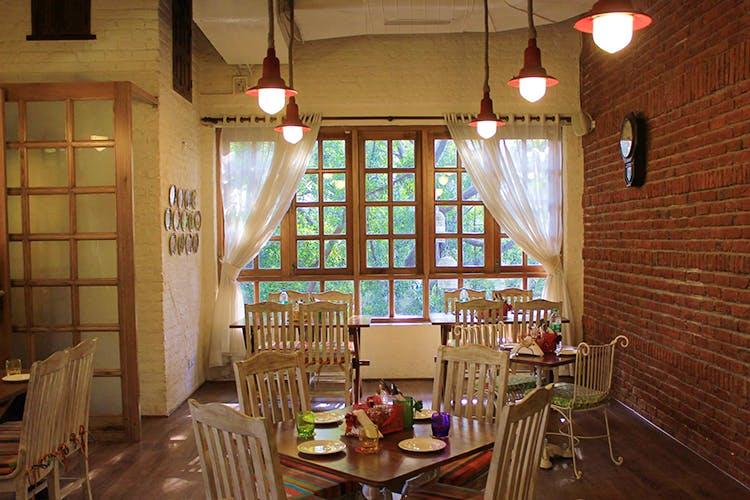 Building,Room,Interior design,Restaurant,Ceiling,Window,Table,Furniture