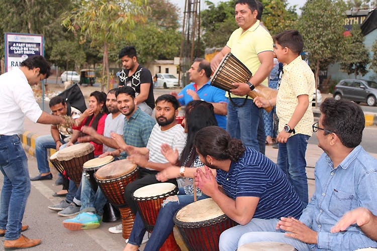 Drum,Community,Youth,Musical instrument,Event,Hand drum,Percussion,Membranophone,Crowd,Leisure
