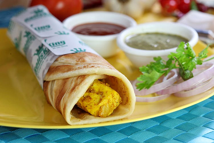 Dish,Food,Cuisine,Taquito,Kati roll,Ingredient,Spring pancake,Sandwich wrap,Wrap roti,Mission burrito