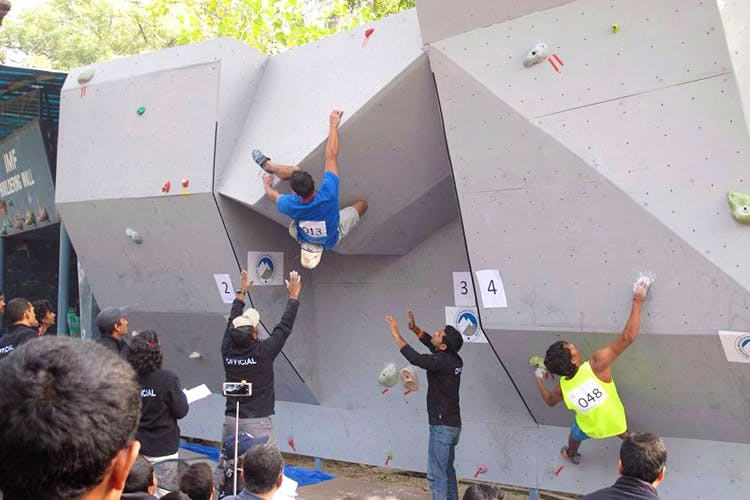 Climbing hold,Climbing,Bouldering,Adventure,Sport climbing,Rock climbing,Recreation,Climbing shoe,Competition event,Individual sports