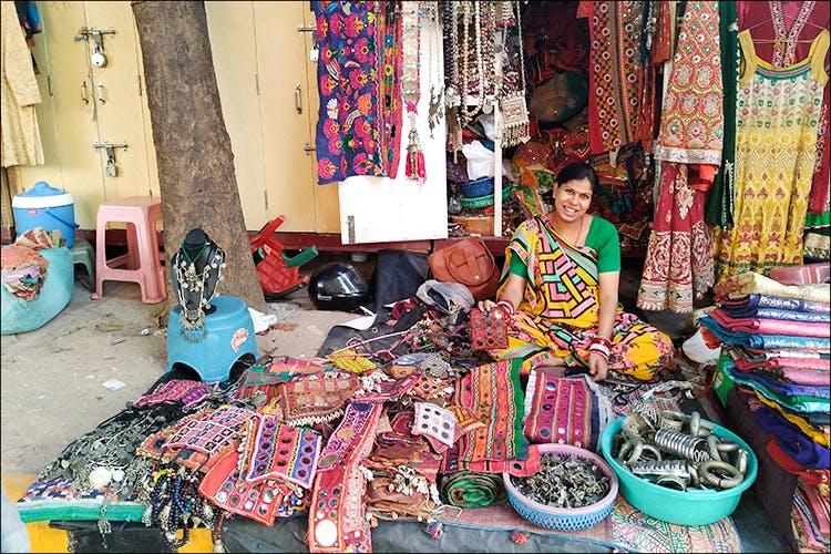 Selling,Market,Bazaar,Public space,Marketplace,Human settlement,Textile,Flea market,City,Shopkeeper