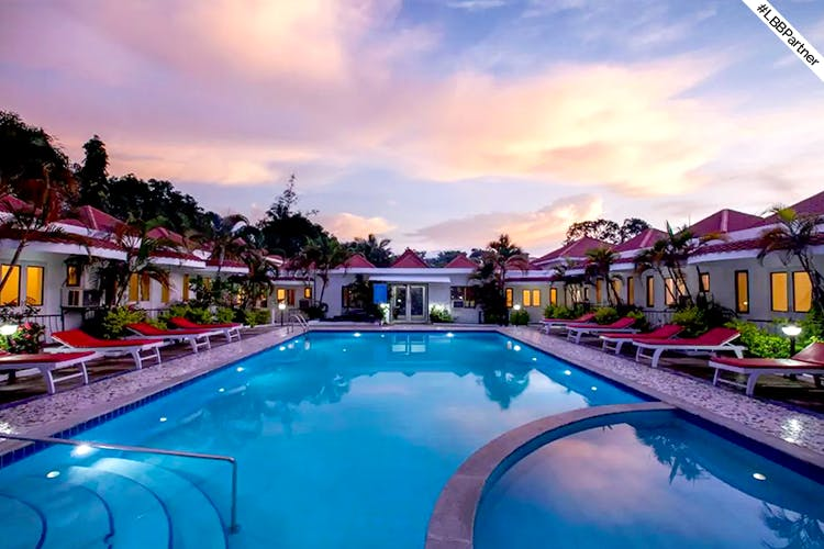 Swimming pool,Resort,Property,Leisure,Resort town,Real estate,Sky,Building,Vacation,Town