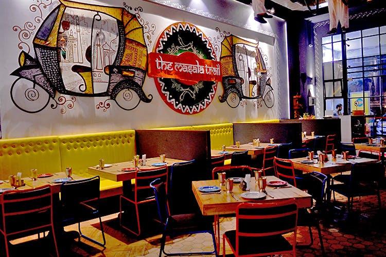 Restaurant,Fast food restaurant,Room,Interior design,Table,Diner,Building,Coffeehouse,Business,Café