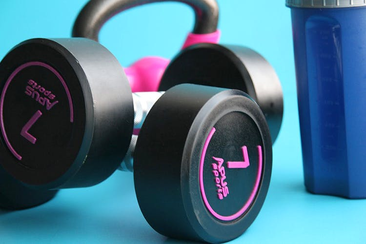 Weights,Headphones,Gadget,Audio equipment,Dumbbell,Exercise equipment,Technology,Physical fitness,Electronic device,Magenta