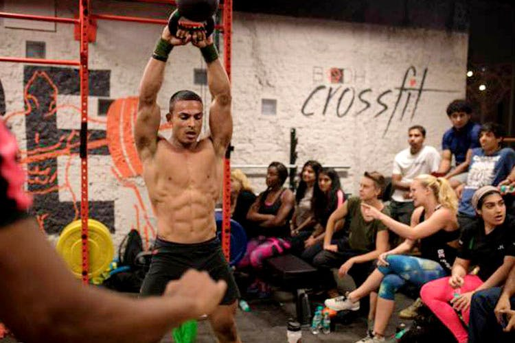 Physical fitness,Crossfit,Event,Room,Barechested,Muscle,Crowd,Exercise,Dance,Chest