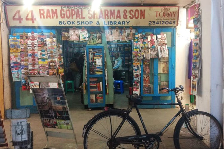 Mode of transport,Transport,Vehicle,Convenience store,Retail,Building,Bookselling,Bicycle wheel,Street
