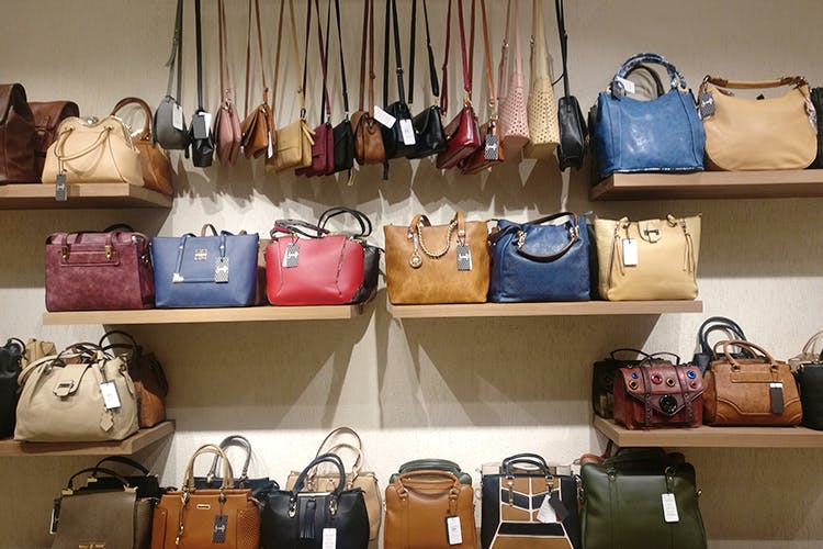 Bag,Handbag,Hand luggage,Baggage,Fashion accessory,Room,Luggage and bags,Collection,Leather,Boutique