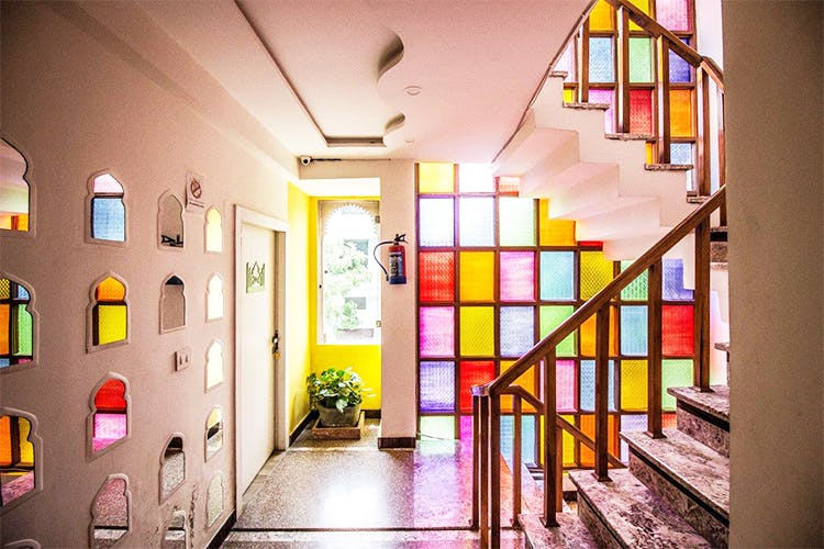 Interior design,Yellow,Building,Room,House,Window,Architecture,Glass,Ceiling,Stairs