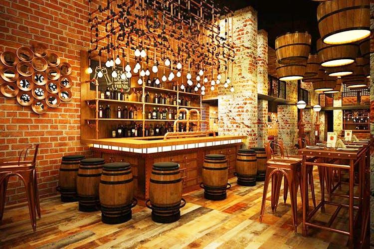 Wine cellar,Building,Drinking establishment,Tavern,Interior design,Pub,Winery,Furniture,Bar