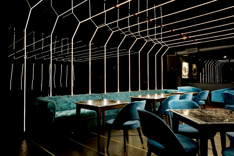 Light,Lighting,Night,Room,Architecture,Table,Chair,Interior design,Building,Darkness