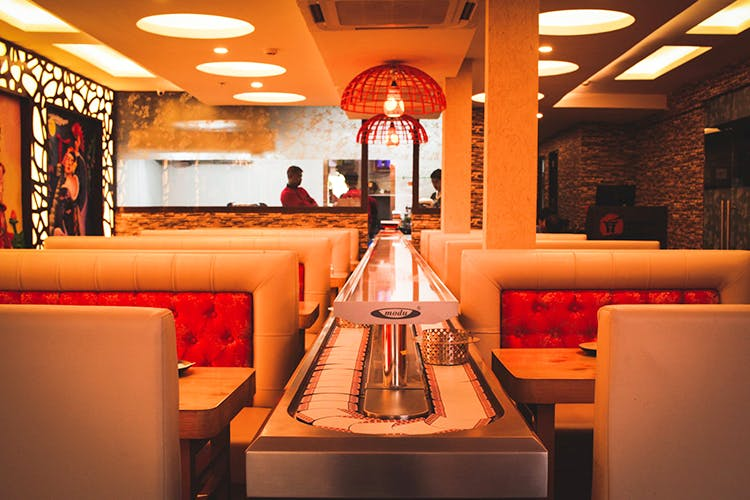 Orange,Interior design,Room,Restaurant,Building,Diner,Fast food restaurant,Coffeehouse,Ceiling