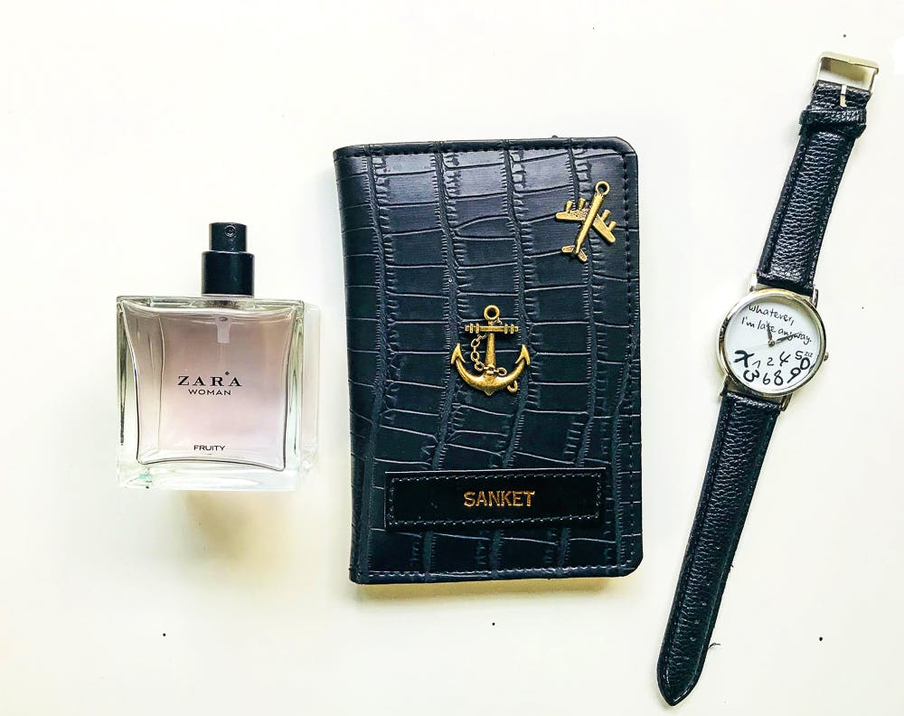 Perfume,Cosmetics,Material property,Watch,Rectangle,Brand,Leather,Strap