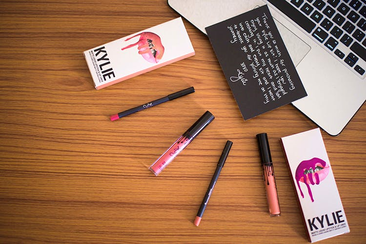Text,Pink,Cosmetics,Material property,Stationery,Font,Paper product,Writing implement,Eye liner,Writing instrument accessory