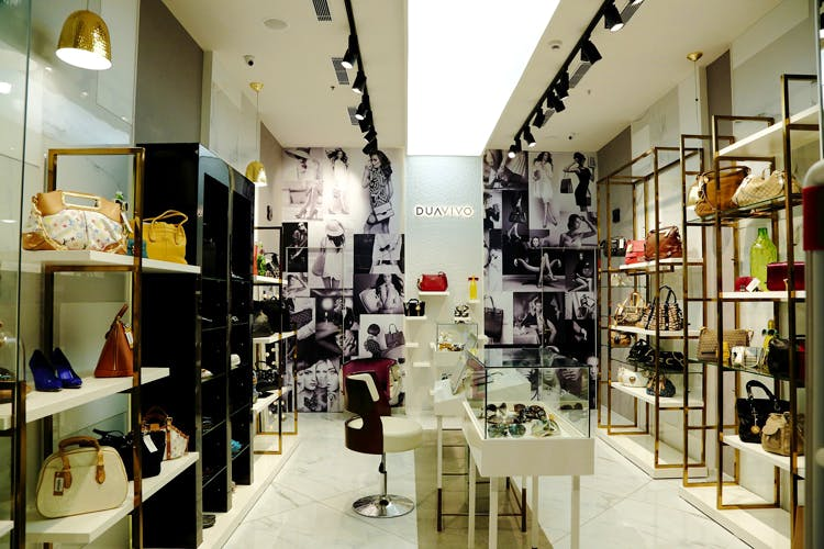 Building,Boutique,Interior design,Outlet store,Retail,Footwear,Eyewear,Collection,Room,Shoe store