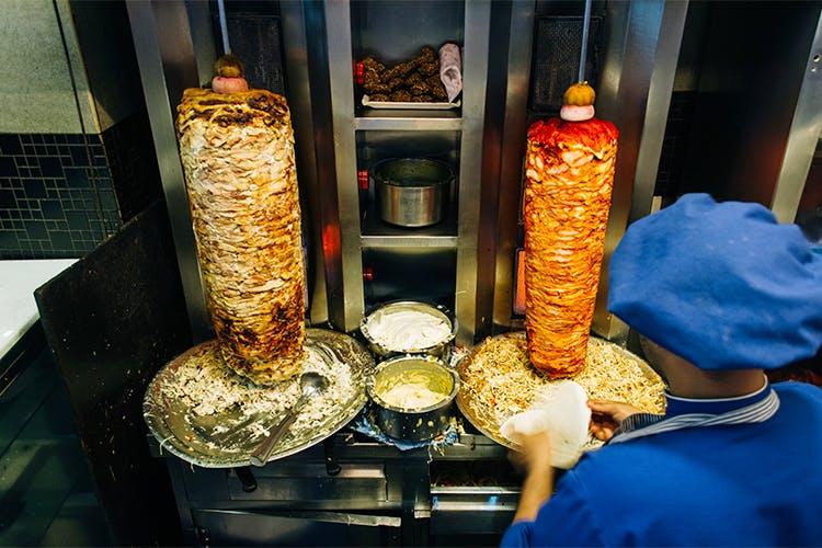 Street food,Food,Snack,Cuisine,Shawarma,Fast food,Dish,Vegetarian food,Mediterranean food