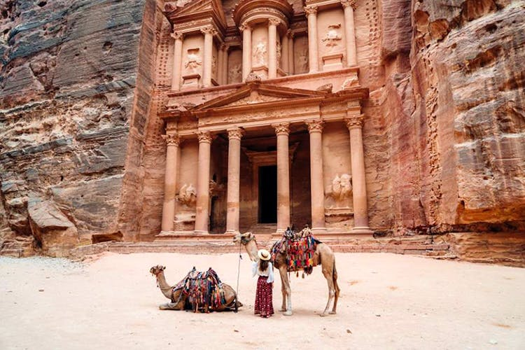 Camel,Ancient history,Arabian camel,Camelid,Historic site,Working animal,Ruins,Building,History,Tourism