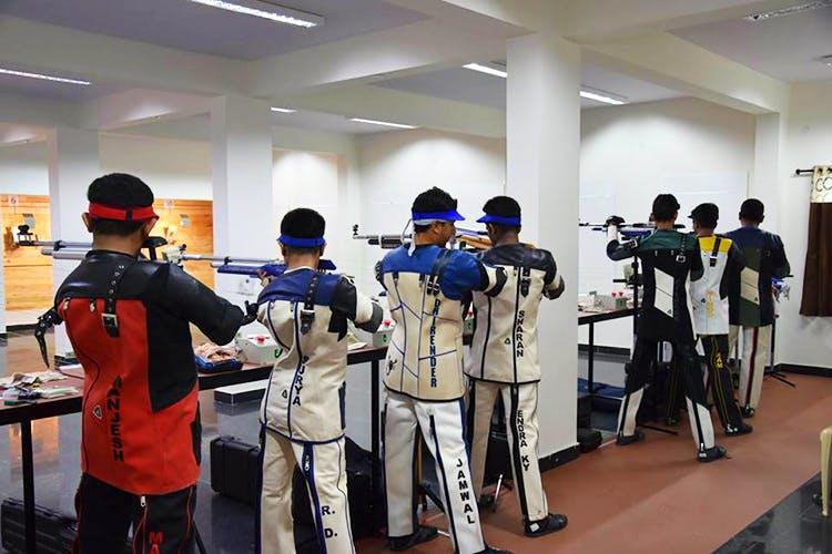 Gun,Shooting sport,Shooting,Recreation,Uniform,Air gun,Firearm,Rifle,Sport venue,Individual sports