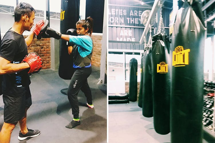 Punching bag,Room,Sportswear,Footwear,Boxing,Photography,Strike,Personal protective equipment,Boxing glove,Shoe
