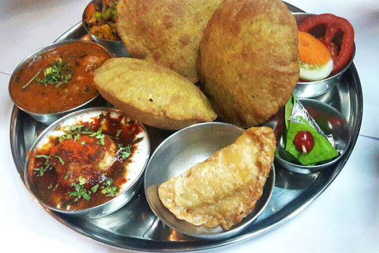 Dish,Food,Cuisine,Ingredient,Puri,Fried food,Produce,Staple food,Punjabi cuisine,Meal