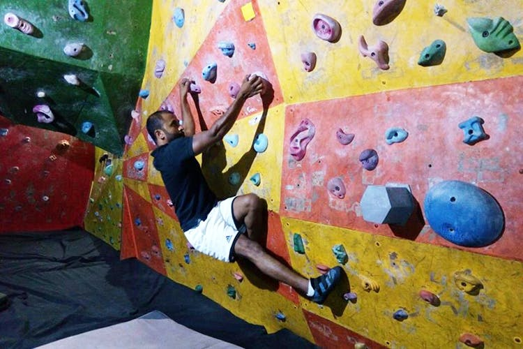 Climbing hold,Climbing,Bouldering,Sport climbing,Rock climbing,Adventure,Free climbing,Recreation,Leisure,Climbing shoe