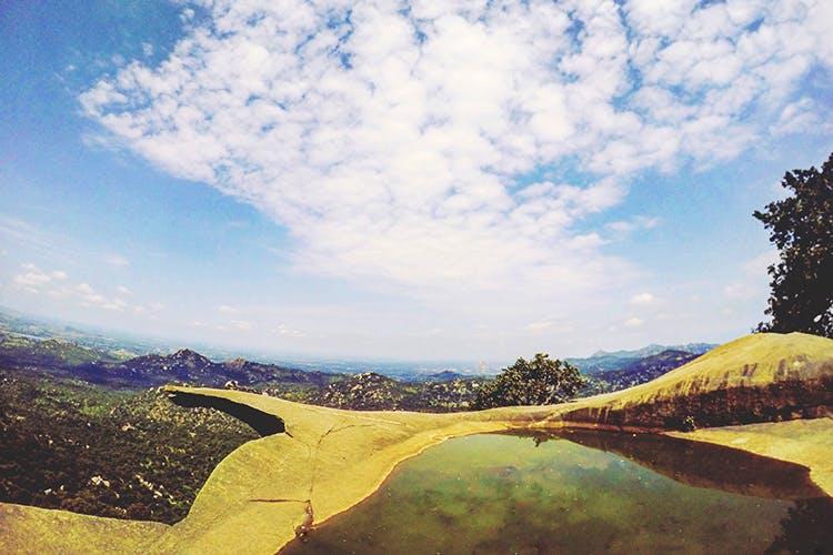 Sky,Highland,Cloud,Wilderness,Hill,Mountain,Tree,Mountain range,Geology,Landscape