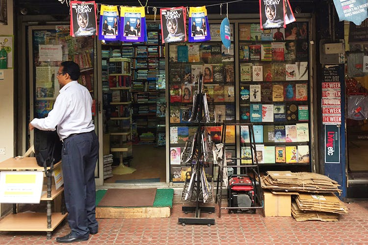 Bookselling,Retail,Selling,Snapshot,Building,Street,Shopkeeper,Publication